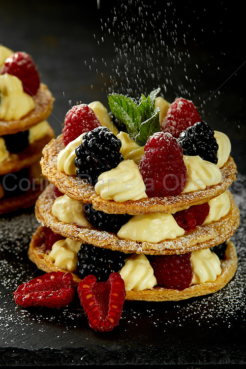 The creamy whims with berries are small cakes of puff pastry custard whipped cream and berries