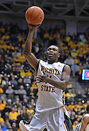 WICHITA, KS - NOVEMBER 14:  Forward Cleanthony Early #11 of the Wichita State Shockers puts up a shot against the William & Mary Tribe during the first half on November 14, 2013 at Charles Koch Arena in Wichita, Kansas.  (Photo by Peter G. Aiken/Getty Images) *** Local Caption *** Cleanthony Early