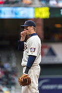 Justin Morneau #33 of the Minnesota Twins tries to stay warm during a cold game against the New York Mets on April 13, 2013 at Target Field in Minneapolis, Minnesota.  The Mets defeated the Twins 4 to 2.  Photo: Ben Krause