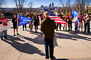 """28 NOVEMBER 2020 - DES MOINES, IOWA: Protesters say the """"Pledge of Allegiance"""" during the """"Stop the Steal"""" rally at the Iowa State Capitol Saturday. About 30 supporters of US President Donald Trump gathered at the Iowa State Capitol to rally in support of the President and in opposition to the outcome of the US election. They are a part of the """"Stop the Steal"""" movement which has spread across the US. This is the fourth week that there have been """"Stop the Steal"""" rallies at state capitols across the US. Most independent observers and election officials, both Republican and Democratic, have said the election was free and fair and that there was no election of fraud.           PHOTO BY JACK KURTZ"""