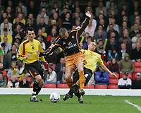 Photo: Lee Earle.<br /> Watford v Wolverhampton Wanderers. Coca Cola Championship. 29/10/2005. Watford's Gavin Mahon (R) slides in on Kenny Miller.