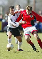 Fotball<br /> Tyskland U 19 v Latvia U 19<br /> 13. mars 2003<br /> Foto: Digitalsport<br /> Norway Only<br /> Jevgemijs Semjonovs fra Latvia og Erdal Kilicaslan fra Tyskland