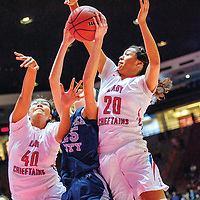 Shiprock Chieftains Evette Lansing (40), left, and Aiona Johnson (20) vie for a rebound with Silver City Fighting Colt Katelynn Limardo (25) in a District 4A quarterfinal at The Pit in Albuquerque Tuesday.
