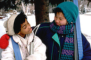 Korean/Am & African Am. friend age 13 & 11 with cross-country skis.  St Paul Minnesota USA