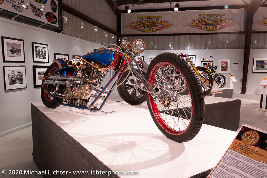 Having been built in 1983, Fred Cuba's split rocker, dual plugged, de-finned Ironhead Sportster digger he named Red Wheel Bike was one of the oldest bikes in the Heavy Mettle exhibition. It is what put Fred on the map nearly 4-decades ago. Here it is on display in the Heavy Mettle - Motorcycles and Art with Moxie exhibition at the Sturgis Buffalo Chip. This is the 2020 iteration of the annual Motorcycles as Art series curated and produced by Michael Lichter. Sturgis, SD, USA. Friday, August 7, 2020. Photography ©2020 Michael Lichter.