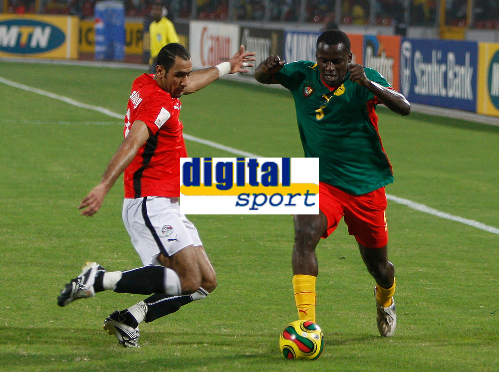 Photo: Steve Bond/Richard Lane Photography.<br /> Egypt v Cameroun. Africa Cup of Nations. 22/01/2008. Mohamed Shawky, (L) about to challange Tchato Bill (R)