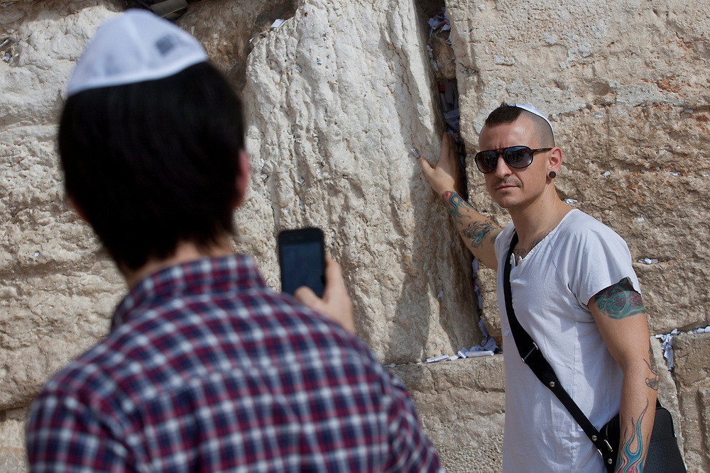 American band Linkin Park member Chester Bennington, right, poses for a photo taken by Mike Shinoda, another member of the band, during a visit to the Western Wall, the holiest site to Judaism, in the Old City of Jerusalem, Israel, on November 15, 2010.