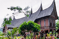 West Sumatra, Bukittinggi. Rumah gadang (Minangkabau: big house with horn-like roof). Traditional Minangkabau home at the museum.