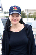 Pauley Perrette who plays NCIS Forensics expert Abby Sciuto meets her Australian equivalents, Garden Island, Sydney-Australia.1/6/10.Paul Lovelace Photography . An instant sale option is available where a price can be agreed on image useage size. Please contact me if this option is preferred.