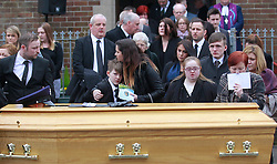 © Licensed to London News Pictures. 22/03/2016. Belfast, Northern Ireland, UK. Sharon Ismay, right, the wife of murdered prison officer Adrian Ismay and family with the coffin after funeral service at Woodvale Methodist church. Mr Ismay died following a booby-trap bomb that exploded under his van in East Belfast on March 4th. Photo credit: Peter Morrison/LNP