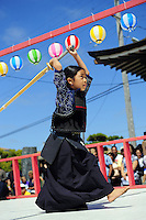 Seven year-old Kha-Ai Pham shows off her sword skills during the kendo demonstration. Jay Dunn/The Salinas Californian