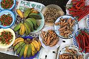 Bananas and chillis etc. for sale in Bandar's riverside market.