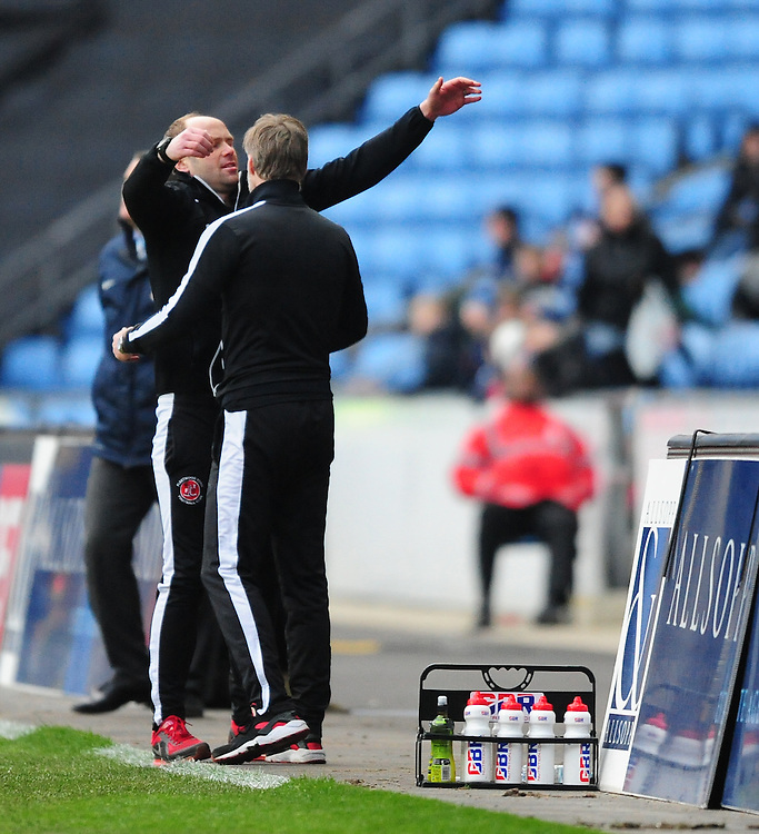 Fleetwood Town's first team coach Neil MacFarlane hugs Fleetwood Town manager Steven Pressley as they celebrate the win over their former club Coventry City<br /> <br /> Photographer Chris Vaughan/CameraSport<br /> <br /> Football - The Football League Sky Bet League One - Coventry City v Fleetwood Town - Saturday 27th February 2016 - Ricoh Stadium - Coventry   <br /> <br /> © CameraSport - 43 Linden Ave. Countesthorpe. Leicester. England. LE8 5PG - Tel: +44 (0) 116 277 4147 - admin@camerasport.com - www.camerasport.com