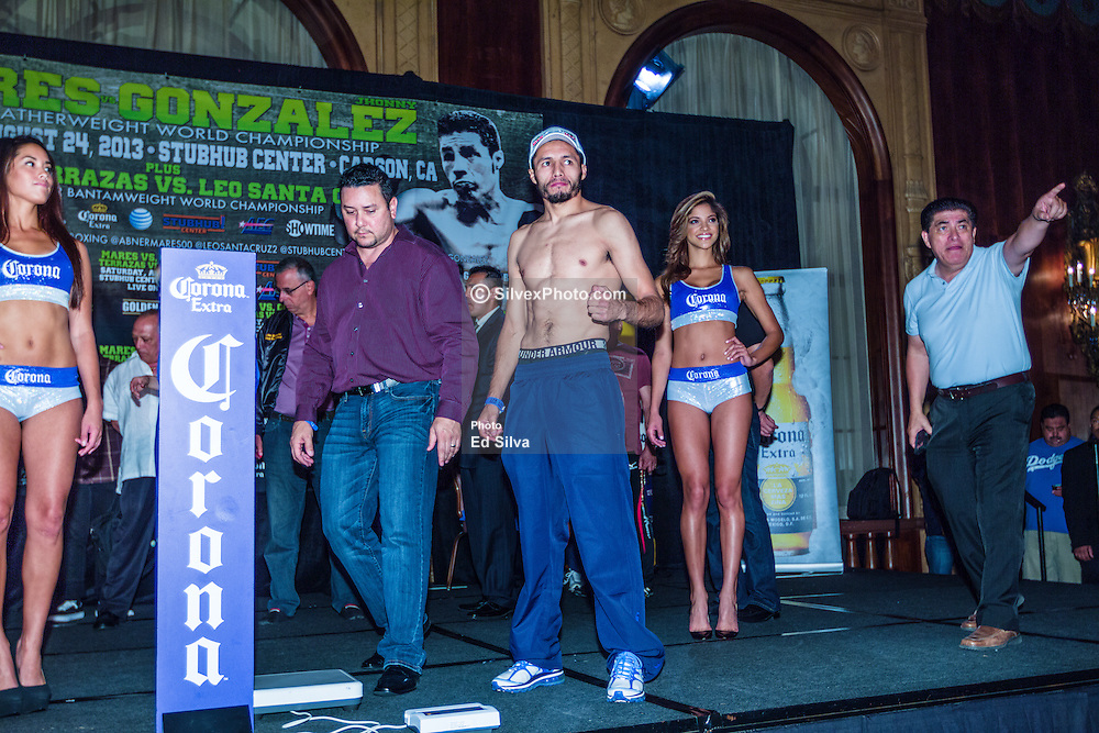 LOS ANGELES, California/USA (Friday, Aug 23 2013) - Abner Mares (L) weighed in at 125.5 pounds for his WBC featherweight title defense against Jhonny Gonzalez (R), who weighed 125 pounds during the weigh in at the Millennium Biltmore Hotel on August 23, 2013 in Los Angeles, California. PHOTO © Eduardo E. Silva/SILVEXPHOTO.COM.