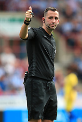 """Referee Chris Kavanagh during the Premier League match at the John Smith's Stadium, Huddersfield. PRESS ASSOCIATION Photo. Picture date: Saturday August 11, 2018. See PA story SOCCER Huddersfield. Photo credit should read: Mike Egerton/PA Wire. RESTRICTIONS: EDITORIAL USE ONLY No use with unauthorised audio, video, data, fixture lists, club/league logos or """"live"""" services. Online in-match use limited to 120 images, no video emulation. No use in betting, games or single club/league/player publications."""