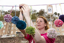 Yarn-bombiong during the Scotland-wide World Heritage Day festivities. Six unique events, coordinated by Dig It! 2017, celebrated Scotland's six World Heritage Sites as part of the 2017 Year of History, Heritage and Archaeology. <br /> <br /> Pictured: Event Manager Lindsay McGhie hanging pom-poms