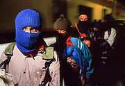FEB 24, 2001 - SAN CRISTOBAL DE LAS CASAS, CHIAPAS, MEXICO: Members of  the EZLN (Zapatistas) march through San Cristobal de las Casas, Chiapas, Mexico, Feb. 24, 2001. The march was to mark the beginning of the Zapatista's caravan from San Cristobal de las Casas to Mexico City. About 3,000 Zapatistas participated in the march through San Cristobal. The Zapatistas went to Mexico City to press their demands for the passage of the San Andres Accords, signed between the Zapatistas and the Mexican government in 1996 but stalled in the Mexican congress by the formerly ruling Institutional Revolutionary Party.  © Jack Kurtz   INDIGENOUS   POVERTY   HUMAN RIGHTS  CIVIL RIGHTS  WAR    VIOLENCE