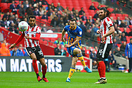 Shrewsbury Town's Shaun Whalley shoots at goal during the EFL Trophy Final match between Lincoln City and Shrewsbury Town at Wembley Stadium, London, England on 8 April 2018. Picture by John Potts.