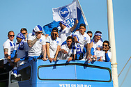 Brighton players on the open top bus spot someone in the crowd during the Brighton & Hove Albion Football Club Promotion Parade at Brighton Seafront, Brighton, East Sussex. United Kingdom on 14 May 2017. Photo by Ellie Hoad.