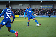 AFC Wimbledon defender Rod McDonald (4) dribbling and about to pass to AFC Wimbledon defender Paul Osew (37) during the EFL Sky Bet League 1 match between AFC Wimbledon and Fleetwood Town at the Cherry Red Records Stadium, Kingston, England on 8 February 2020.