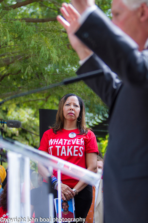 """Lucy McBath, listens as Virginia Governor, Terry McAuliffe speaks at a rally organized to support victims of gun violence and pressure politicians to do """"whatever it takes"""" to prevent gun violence.  McBath lost her son to gun violence when Michael Dunn fired a gun into a car with her son and several other teenagers back in November 2012.  Andy Parker, made his first visit to Washington, D.C. since his daughter, WDBJ_TV reporter, Alison Parker, was shot and killed on live television near Roanoke, VA last week.  The rally, organized by Everytown for Gun Safety, brought Parker together with Virginia Senators, Mark Warner, Tim Kaine and Virginia Governor, Terry McAuliffe near the United States Capitol, on Thursday, September 10, 2015.  John Boal/for The New York Daily News"""