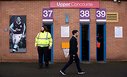 Fans arrive at the ground before the Premier League match at Turf Moor, Burnley.