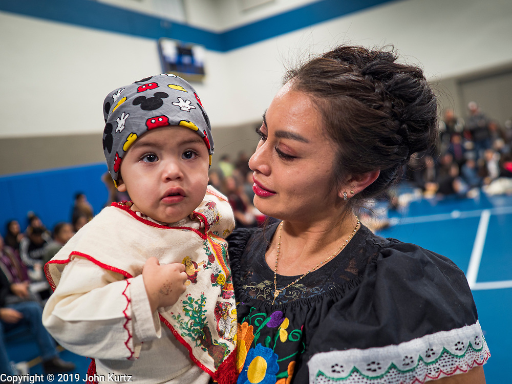 11 DECEMBER 2019 - DES MOINES, IOWA: A woman and her son, dressed as Juan Diego, the indigenous Mexican peasant, during the Virgin of Guadalupe celebration at Our Lady of the Americas Catholic Church in Des Moines. Virgin of Guadalupe Day is one of the most important holy days in Mexican Catholicism. It marks Dec. 12, 1531, the day Juan Diego, an indigenous Mexican peasant, saw an apparition of the Virgin Mary on a barren hillside in what is now Mexico City. A basilica was built on the site. Virgin of Guadalupe Day is celebrated throughout Mexico and in Mexican communities in the United States.                PHOTO BY JACK KURTZ
