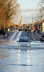 © Licensed to London News Pictures. Date 9 Jan 2014. Oxford. Floods on Botley road with Oxford Spires as a backdrop. River Thames floods at Oxford causing the closure of the Abingdon and Botley roads.. Photo credit : MarkHemsworth/LNP