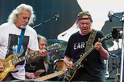 "© Licensed to London News Pictures. 12/07/2014. London, UK.   Neil Young and Crazy Horse performing live at Hyde Park as part of the British Summer Time series of outdoor concerts.In this picture - Neil Young (right), Frank Sampredo (left), Rick Roses (centre).   Crazy Horse is a rock band long associated with Neil Young,  consisting of members Rick Roses, (bass, vocals), Ralph Molina (drums, vocals), Frank ""Poncho"" Sampedro ( guitar, organ, keyboards).  Photo credit : Richard Isaac/LNP"