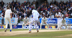 West Indies Kyle Hope (centre) is run out by England's Stuart Broad during day five of the the second Investec Test match at Headingley, Leeds. PRESS ASSOCIATION Photo. Picture date: Tuesday August 29, 2017. See PA story CRICKET England. Photo credit should read: Nigel French/PA Wire. RESTRICTIONS: Editorial use only. No commercial use without prior written consent of the ECB. Still image use only. No moving images to emulate broadcast. No removing or obscuring of sponsor logos.