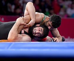 Jakarta, Aug 19,2018  Alireza Karimimachiani (Top) of Iran competes during Men's Wrestling Freestyle 97 kg Final against Magomed Musaev of Kyrgyzstan at the 18th Asian Games at Jakarta, Indonesia, Aug. 19, 2018. (Credit Image: © Yue Yuewei/Xinhua via ZUMA Wire)