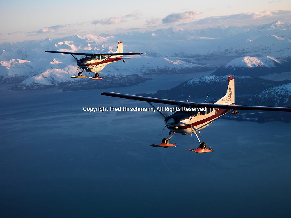 Sky Trekking Alaska's Cessna 180 and Cessna 185 on wheel-skis flying over the Prince William Sound, Alaska.