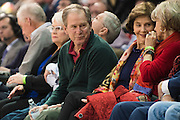 DALLAS, TX - DECEMBER 16: Former U.S. President George W. Bush and his wife Laura Bush visit with fans during an NCAA basketball game between the SMU Mustangs and the Nicholls State Colonels on December 16, 2015 at Moody Coliseum in Dallas, Texas.  (Photo by Cooper Neill/Getty Images) *** Local Caption *** George W. Bush; Laura Bush
