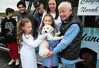 """Norah Boissonault along with her family Andrew, Nicolas, Aaron, Amanda and Zoey receive """"Luna"""" a diabetic alert service dog from Kevin Morris.  This is the first year of giving a service dog to a child in need in memory of Morris' daughter Mandy. Karen Bobotas photo/for the Laconia Daily Sun"""