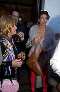 Lady Wyatt and Kate Hatch. Spectator party. Doughty St. London. 28 July 2005. ONE TIME USE ONLY - DO NOT ARCHIVE  © Copyright Photograph by Dafydd Jones 66 Stockwell Park Rd. London SW9 0DA Tel 020 7733 0108 www.dafjones.com