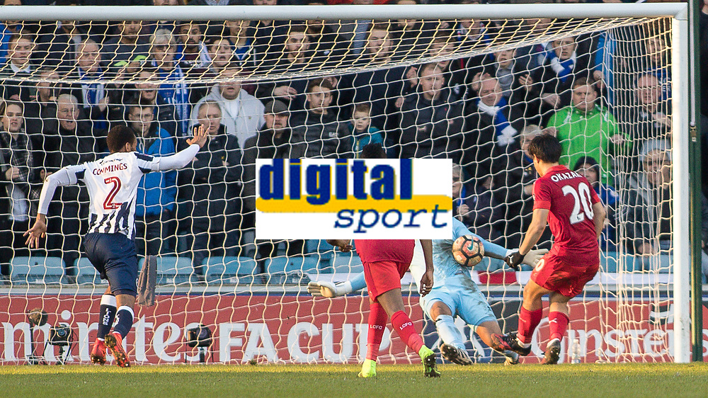 Football - 2016 / 2017 FA Cup - Fifth Round: Millwall vs. Leicester City <br /> <br /> Jordan Archer of Millwall spreads himself to save from Shinji Okazaki of Leicester City at point blank range at The Den<br /> <br /> COLORSPORT/DANIEL BEARHAM