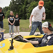 During a taping for ESPN's Sportscenter, NASCAR driver Dale Earnhardt Jr. helps start one of his go-carts for Jeffrey, 15, whose dream, through Make-A-Wish,was to meet Earnhardt. Jeffrey got a tour of Earnhardt's residence and garage, and got the chance to race Jr. on one of his go-kart tracks. ©Travis Bell Photography