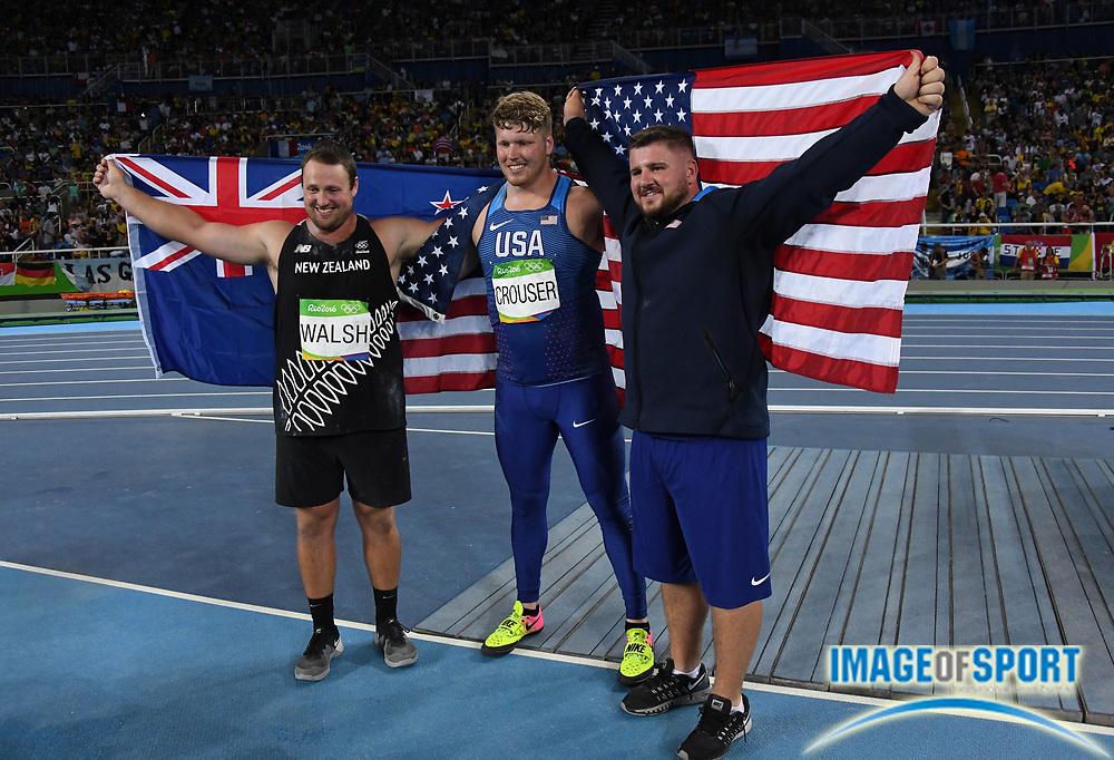 Aug 18, 2016; Rio de Janeiro, Brazil; Shot put winner Ryan Crouser (USA), poses with silver medalist Joe Kovacs (USA), right, and bronze medalist Tomas Walsh (NZL) during the 2016 Rio Olympics at Estadio Olimpico Joao Havelange.