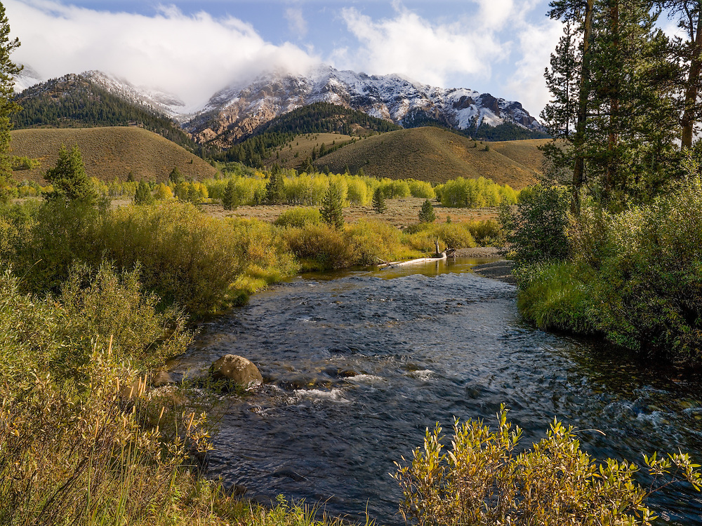 Early fall and lifting storm starts to push summer out along the Wood River at the base of the Boulder Mountains near Sun Valley Idaho. Licensing and Open Edition Prints.