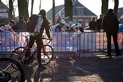 Peloton speed through Dwingeloo as the sun starts to set - Drentse 8, a 140km road race starting and finishing in Dwingeloo, on March 13, 2016 in Drenthe, Netherlands.