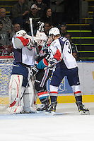KELOWNA, CANADA, OCTOBER 5: Carter Rigby #11 of the Kelowna Rockets is checked between Tri City Americans' goalie, Ty Rimmer #35 and defenceman Sam Grist #3 on October 5, 2011 at Prospera Place in Kelowna, British Columbia, Canada (Photo by Marissa Baecker/shootthebreeze.ca) *** Local Caption ***Ty Rimmer;Carter Rigby;Sam Grist;