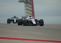October 20, 2018 - Austin, USA - Williams Martini Racing driver Sergey Sirotkin (35) of Russia comes over the hill at Turn 10 with Mercedes AMG Petronas driver Valtteri Bottas (77) of Finland following during qualifying at the Formula 1 U.S. Grand Prix at the Circuit of the Americas in Austin, Texas on Saturday, Oct. 20, 2018. (Credit Image: © Scott Coleman/ZUMA Wire)