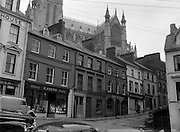 30/03/1957 <br /> Views of towns in Ireland. Rahilly Street, Cobh, Co. Cork (Welcome Inn on right) with Cathedral in Background.