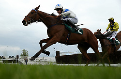 Jockey Brian Hughes ridding his horse Coologue in the Llewellyn Humphreys Handicap Chase 3.50pm race during the April Meeting at Cheltenham Racecourse