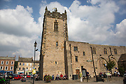 Richmond is a market town and the centre of the district of Richmondshire. Historically in the North Riding of Yorkshire, it is situated on the edge of the Yorkshire Dales National Park. North Yorkshire, England, UK. Trinity Church Square.