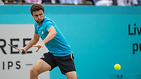 Tennis - 2019 Queen's Club Fever-Tree Championships - Day Seven, Sunday<br /> <br /> Men's Singles Final: Feliciano Lopez (ESP) Vs. Gilles Simon (FRA)<br /> <br /> Gilles Simon (FRA) opens his frame to power the forehand on Centre Court.<br />  <br /> COLORSPORT/DANIEL BEARHAM