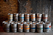 Beer barrels await collection under a railway arch. The ale industry in particular has survived well during difficult economic times as pubs have increased their sales of ales.