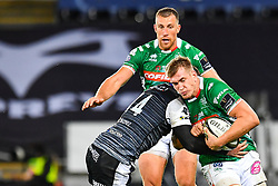 Braam Steyn of Benetton Treviso is tackled by George North of Ospreys<br /> <br /> Photographer Craig Thomas/Replay Images<br /> <br /> Guinness PRO14 Round 4 - Ospreys v Benetton Treviso - Saturday 22nd September 2018 - Liberty Stadium - Swansea<br /> <br /> World Copyright © Replay Images . All rights reserved. info@replayimages.co.uk - http://replayimages.co.uk