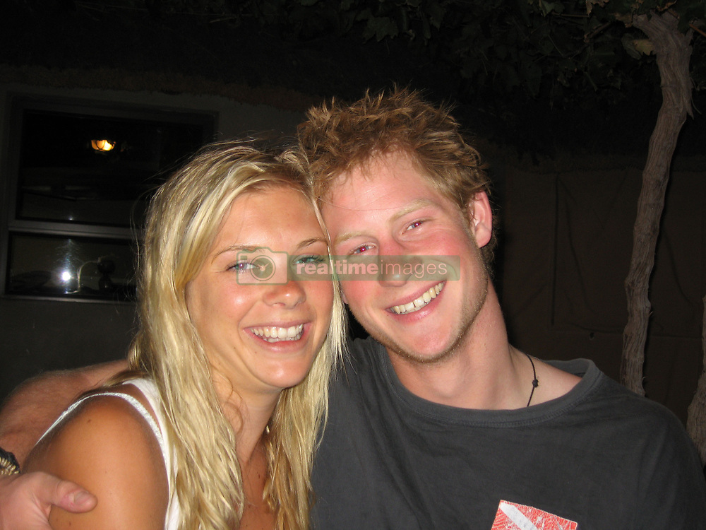 June 27, 2009 - Orange River, South Africa - PRINCE HARRY and CHELSY DAVY vacationing on the Orange River. While last month's tabloids were speculating that Harry and Chelsy were over for good, snaps from the couple's recent Zambian holiday showed them as happy as they were on the Orange River in November 2006.   On that four-day, 60 km canoe adventure, as these never before published photos show, it looked like the couple are destined to be together forever. Out there on the river that snakes through a remote, unforgiving desert landscape on South African's Namibian border, Harry and Chelsy paddled and partied with a group of her closest friends. He let his hair down enough to try snorting rum out of a bottle top. And in those long hours alone in a canoe with Chelsy, he was simply the bloke she fell in love with two years earlier; the romantic who would later write, ''You are the most beautiful thing I've ever seen. You must have been the big man upstairs' first creation!! The Orange River undoubtedly left an indelible impression on the young prince who, a few weeks later, revealed to a friend that he was mourning Africa and his girl like crazy. ''Of ALL the things in the world right now that I wanna be doing,'' he wrote, ''being with my girl anywhere in Africa would top absolutely everything. Drifting underneath the blue carpet, talking shit to each other without a single person, soul or noise for miles and miles! Then as the sun goes to rest and turns the sky orange, to be snuggled up in a bed roll, under the stars, with all the time in the world to do whatever the fuck we wanted!'' (Credit Image: © Whitehotpix/ZUMApress.com)
