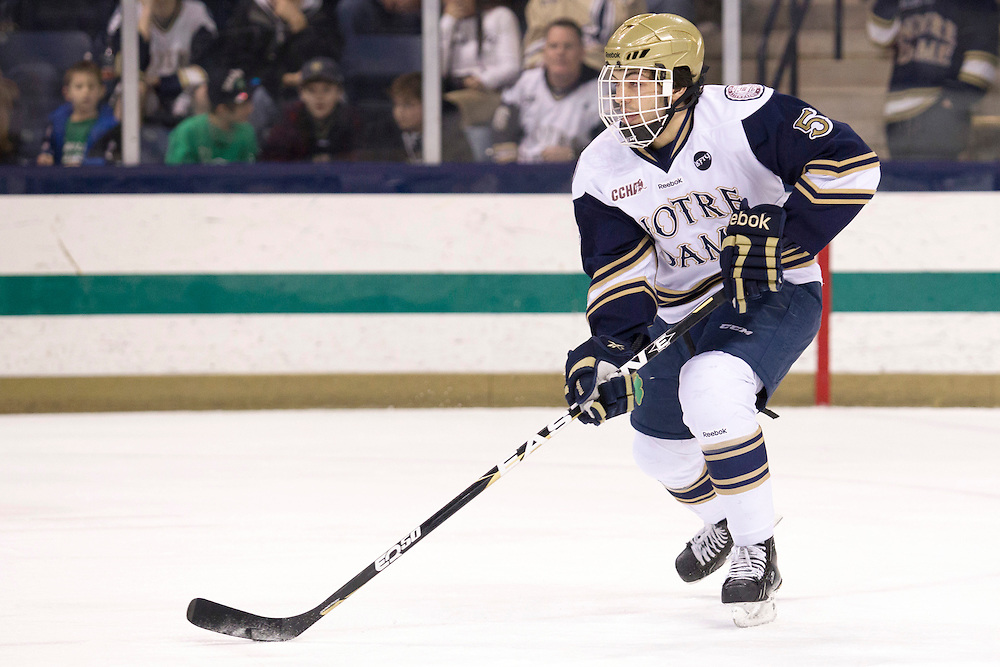Notre Dame defenseman Robbie Russo (#5) skates with the puck in second period action of NCAA hockey game between Notre Dame and Ohio State.  The Notre Dame Fighting Irish defeated the Ohio State Buckeyes 4-2 in game at the Compton Family Ice Arena in South Bend, Indiana.